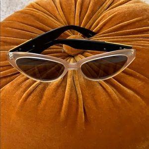 Cool vintage sunglasses. Cat eye with lion design.